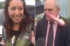 Police apprehend Josie Butler after Government minister Steven Joyce is hit in the face by a pink dildo thrown at him. Photo / Newshub