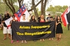 An Asian group from Auckland joined Saturday's hikoi to show their support for Maori sovereignty, with Julie Zhu (right) and Mengzhu Fu (second from right). Photo / Peter de Graaf