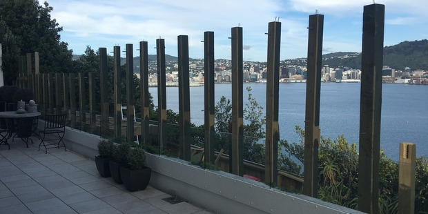 The four-metre-high wooden fence blocking the view of Wellington City and Harbour is being taken down. Photo / Solbin Kang