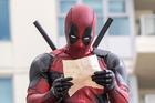 Ryan Reynolds as Deadpool relaxes before leaping into battle in the film Deadpool. Photo / David Dolsen, Twentieth Century Fox
