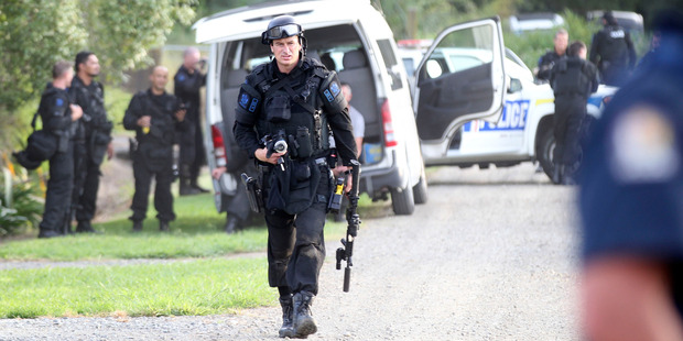Armed police cordoned off streets as Armed Offenders Squad went to a house in Carroll St. Photo / Duncan Brown