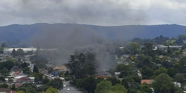 A large, dark plume of smoke can be seen across New Lynn at the moment. Photo: Twitter/@stevenb76