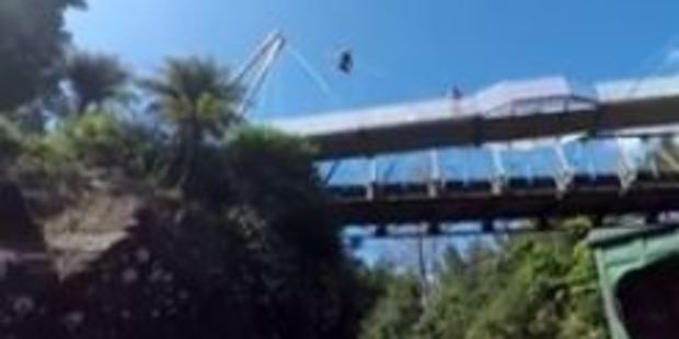 The moment a fearless bridge jumper plunged more than 20 metres into a tiny pool of water. Photo: Matt Harvey/Facebook