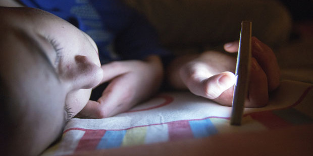Data recovery company Computer Forensics NZ is offering services that allow concerned parents to access and recover data from their children's phones. Photo / iStock