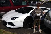 Alex Faulkner, 9, with a white Lamborghini outside Lynn Mall. Photo / Supplied