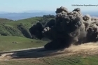 Raw: US Marines use explosives to clear minefield