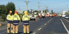 Emergency services work to clear the road. Photo / Craig Baxter, Otago Daily TImes
