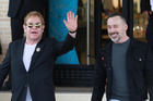Sir Elton John has defended his husband David Furnish against claims he is too controlling. Photo / Splash