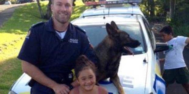 Caroliah Vaigafa with Constable Matthew Gibson and Ulster the dog.