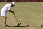 Joe Hogan from Gisborne, the first-ever world croquet champion, competing in the New Zealand men's singles championships at the Rangatira greens.