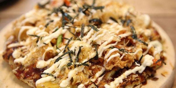Enjoy traditional Okonomiyaki at an izakaya. Photo / 123RF