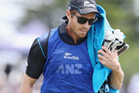 Tim Southee runs the 12th man duties during a ODI for the Black Caps. Photo / Getty