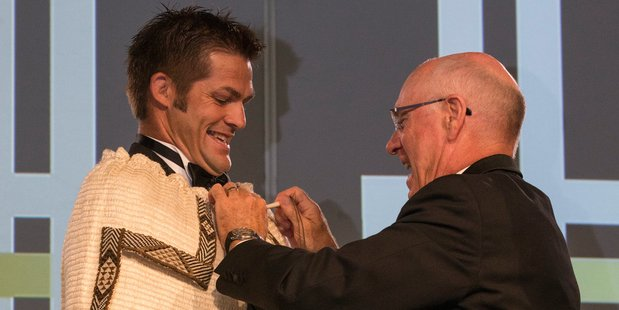 Richie McCaw was draped with a traditional Maori cloak after being announced as the winner of the award. Photo / Greg Bowker