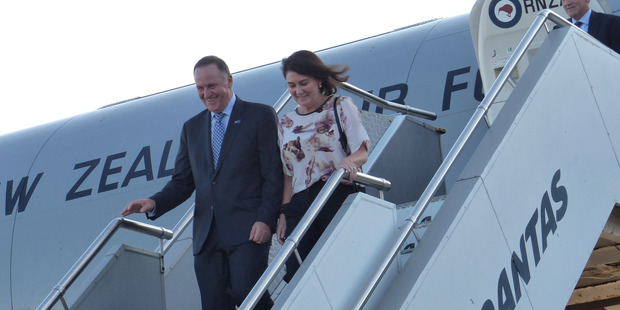 Prime Minister John Key and Bronagh Key arriving in Syndey last night. He has agreed to release a text from gossip columnist Rachel Glucina. Photo / Audrey Young