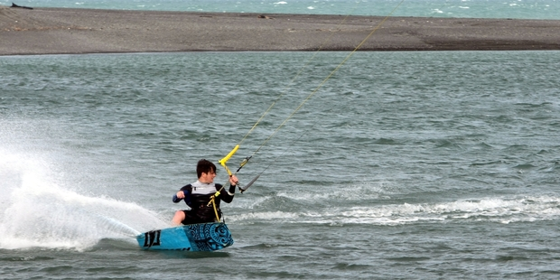 A kite surfer enjoys the windy weather conditions at the Waitangi basin near Napier. Photo / Paul Taylor