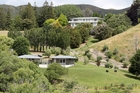 Bankrupted Garth Paterson was director of GLW Group, which has its name on the title of a 24.3ha subdivision on the Tukituki River's Horseshoe Bend near Havelock North. The house above is the home of Black Barn co-founder Andy Coltart.