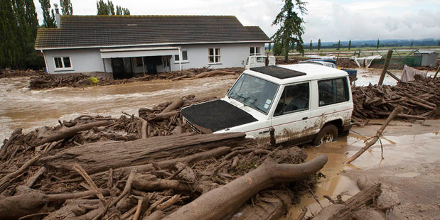 """Loading The road is """"completely washed out"""". Photo / Ben Fraser"""