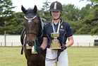 Rebecca Aplin and Woodlands Park Light O Day with their trophy haul after the New Zealand Pony Club Dressage Championships in Dannevirke. Photo / Alison Price Spot-On Photography