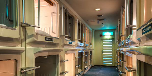 Capsule hotels offer a uniquely Japanese accommodation experience - and it's cheap. Photo / 123RF