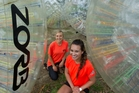 Zorb Rotorua staff Kelsey Horne (left) and Katea Graham. The tourist attraction is back in operation after being granted a temporary exemption. Photo / Stephen Parker