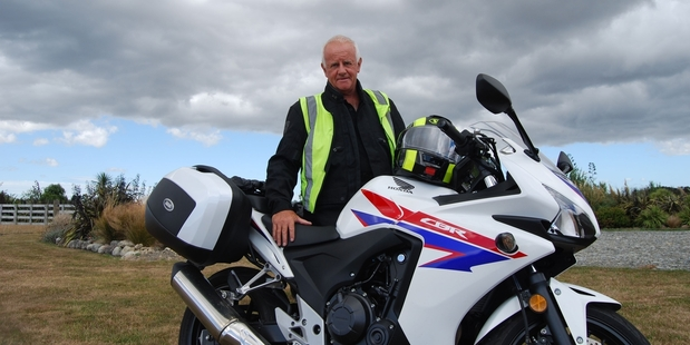 RIDER: Ulysses Club committee member Mike Purcell with his Honda CBR500R. PHOTO/ALISA YONG