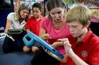 Sign language teacher Kath Shepherd (left) works with hearing-impaired student Starr Phillips and Averill Wilbraham works with hearing impaired student Dontaey Hill at Ebbett Park School, Hastings. Photo / Warren Buckland