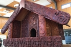 The carved whatarangi (elevated storehouse) created at the New Zealand Maori Arts and Crafts Institute at Te Puia. A bronze replica is proposed to be gifted to the United Nations.
