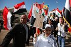 Druze residents of the Buqata village in the Israeli annexed Golan Heights wave Syrian flags and a placard depicting a portrait of Syrian President Bashar al-Assad. Photo / AFP