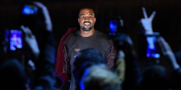 Rapper Kanye West has begged his fans to sign up to Tidal. Photo / AFP