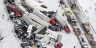 The pileup left vehicles tangled together across several lanes of traffic. Photo / AP