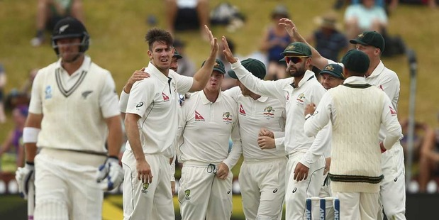 Loading Mitch Marsh of Australia celebrates after taking the wicket of Corey Anderson of New Zealand during day four of the Test match between New Zealand and Australia. Photo / Getty Images.