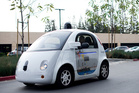 A self-driving car traverses a parking lot at Google's headquarters in California. Photo / AFP