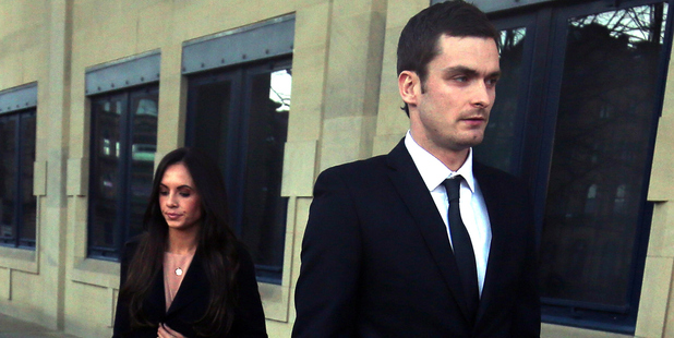 Adam Johnson and his partner Stacey Flounders leave court. Photo / Getty Images