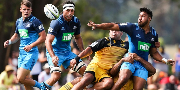George Moala offloads during the Super Rugby pre-season match against the Hurricanes. Photo / Getty