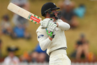 Henry Nicholls in action for New Zealand during day four of the first test against Australia at the Basin Reserve. Photo/Getty