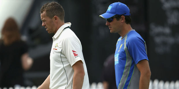 Peter Siddle walks off the field with the team physio. Photo / Getty