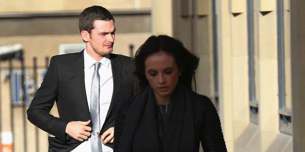 Adam Johnson and his girlfriend Stacey Flounders arrive at Bradford Crown Court. Photo / Getty Images