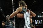 Tom Abercrombie is congratulated by Tai Wesley after the Breakers swept Melbourne. Photo / Getty
