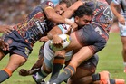 Konrad Hurrell of the World All Stars fights through the defence to score a try during the NRL match between the Indigenous All-Stars and the World All-Stars. Photo / Getty Images.