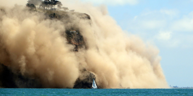 Godley Head on Banks Peninsula wreathed in dust after the 5.7 earthquake. Photo / Andy Winneke