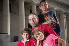 Mohammed Alqoq with his children (from left) Omar, 3, Alma, 9, and Naser, 8, will settle in Wellington. Photo / Jason Oxenham