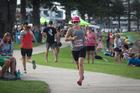 Aliesha Lloyd  runs a team leg during the Foundation Clinic Mauao Half Marathon on Saturday. Photo / Andrew Warner