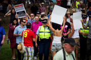 TPP protestors harass Prime Minister John Key during the Big Gay Out held at Coyle Park, Pt Chevalier. Photo / Dean Purcell