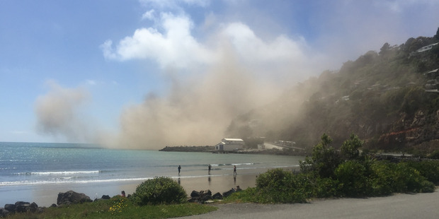 Damage from yesterday's earthquake in Christchurch. The dust cloud pictured resulted from a cliff collapse near Sumner. Photo / Andrew Watson