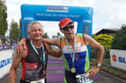 Ray Lichtwark and Steve Currie embrace after their 33rd Taupo triathlons. PHOTO/SCOTT TAYLOR