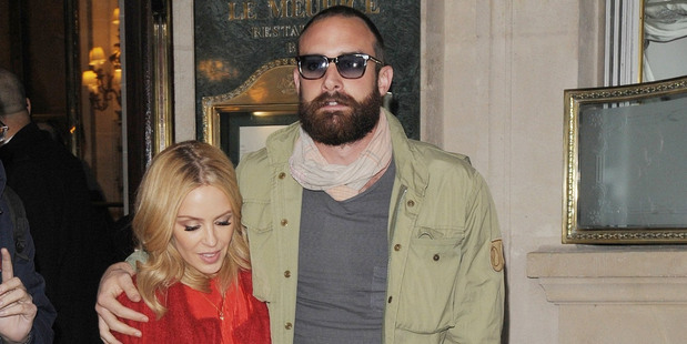 Kylie Minogue has sparked rumours she may be engaged to boyfriend Joshua Sasse after being spotted wearing a large diamond ring.