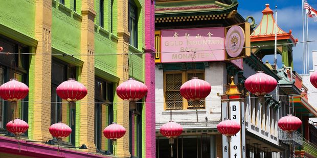 Pink chinese lamps hanging on the street in China Town, San Francisco.