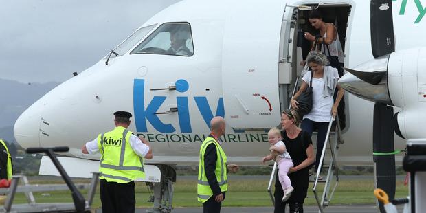 First passengers off the first Nelson to Tauranga Kiwi Air direct flight yesterday Sheree Seyb, and daughter Edan. Photo / John Borren
