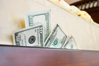 The time has come in some countries when hiding money under your mattress might be a good choice. Photo / Getty Images