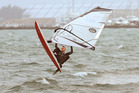 A windsurfer makes the most of the windy conditions off Kulim Park. Photo / John Borren